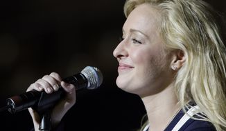 ** FILE ** In this undated file photo, country singer Mindy McCready performs in Nashville, Tenn. McCready, who hit the top of the country charts before personal problems sidetracked her career, died Sunday, Feb. 17, 2013. She was 37. (AP Photo/Mark Humphrey, File)