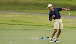 **FILE** President Obama watches the ball after making a putt on the ninth green during his golf match at the Mid-Pacific County Club in Kailua, Hawaii, on Dec. 31, 2009. (Associated Press)