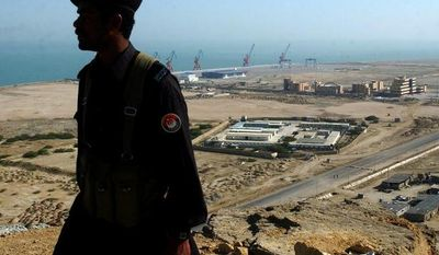 **FILE** A Pakistani soldier of Pakistan's paramilitary force is silhouetted at the Gwadar port, 700 kilometers (435 miles) from Karachi, Pakistan, on Feb. 6, 2007. (Associated Press)