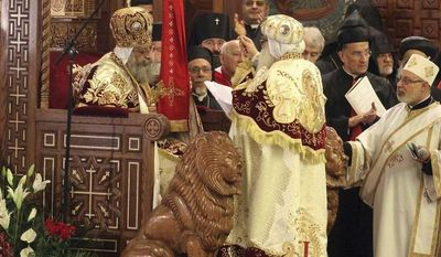 ** FILE ** Pope Tawadros II, 60, sits on the throne of St. Mark, the Coptic Church's founding saint, wearing the papal crown, during an elaborate ceremony lasting nearly four hours and attended by the nation's Muslim prime minister and a host of Cabinet ministers and politicians, in the Coptic Cathedral in Cairo on Sunday, Nov. 18, 2012. (AP Photo/Sami Wahib)