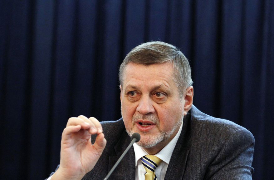 Jan Kubis, the top U.N. envoy in Afghanistan, presents the annual U.N. report on Afghan civilian casualties at a press conference in Kabul, Afghanistan, on Tuesday, Feb. 19, 2013. (AP Photo/Ahmad Jamshid)