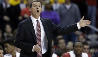 **FILE** Maryland head coach Mark Turgeon directs his players in the first half of an NCAA college basketball game against Duke in College Park, Md., Saturday, Feb. 16, 2013. (AP Photo/Patrick Semansky)
