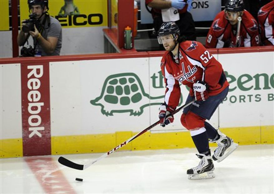 Washington Capitals defenseman Mike Green (52) skates with the puck during the third period of an NHL hockey game against the Philadelphia Flyers, Friday, Feb. 1, 2013, in Washington. The Capitals won 3-2. (AP Photo/Nick Wass)