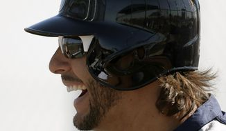 Seattle Mariners left fielder Michael Morse laughs with teammates during a baseball spring training workout Tuesday, Feb. 19, 2013, in Peoria, Ariz. (AP Photo/Charlie Riedel)