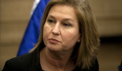 ** FILE ** Former Israeli Foreign Minister Tzipi Livni attends a news conference at the Knesset, Israel's parliament, in Jerusalem on Wednesday, Nov. 30, 2011. (AP Photo/Sebastian Scheiner)