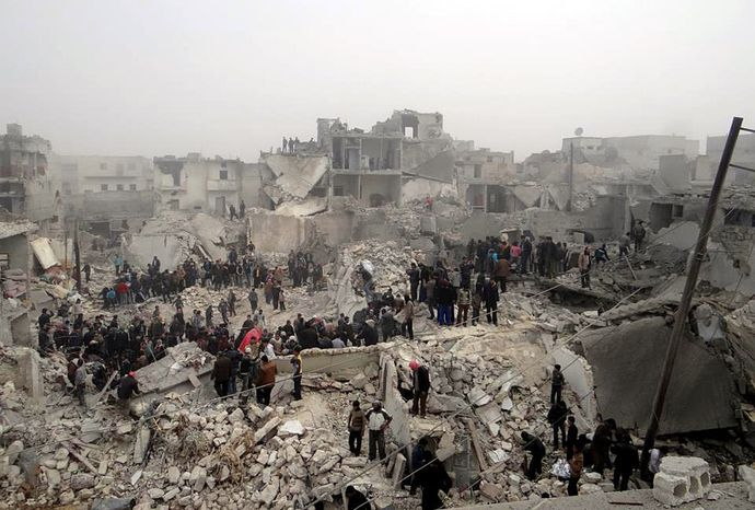 Searchers comb through the debris of destroyed buildings in the aftermath of a strike by Syrian government forces in the Jabal Bedro neighborhood of Aleppo, Syria, on Tuesday, Feb. 19, 2013, in this citizen journalism image provided by the Aleppo Media Center and authenticated based on its contents and other AP reporting. (AP Photo/Aleppo Media Center)