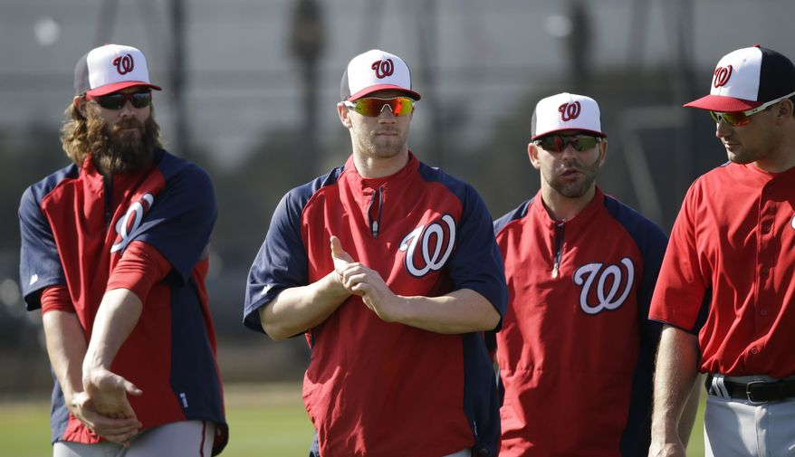 Washington Nationals, from left to right, Jayson Werth, Bryce Harper, Danny Espinosa and Ryan Zimmerman stretch during a spring training baseball workout Tuesday, Feb. 19, 2013, in Viera, Fla. (AP Photo/David J. Phillip)