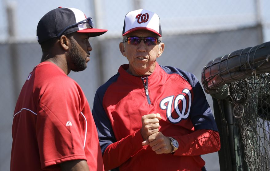 Washington Nationals manager Davey Johnson, right, talks with Denard Span, left, during a spring training baseball workout Tuesday, Feb. 19, 2013, in Viera, Fla. (AP Photo/David J. Phillip)