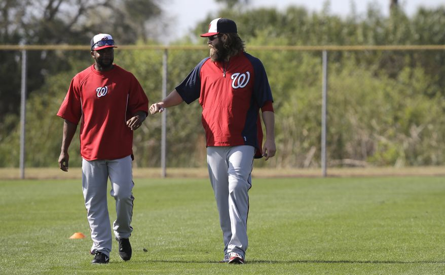 Washington Nationals outfielders Jayson Werth, right, and Denard Span, left, talk during a spring training baseball workout Tuesday, Feb. 19, 2013, in Viera, Fla. (AP Photo/David J. Phillip)