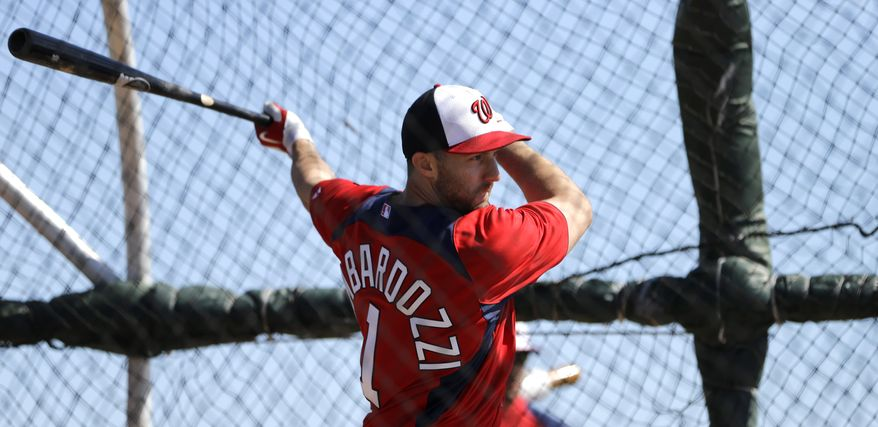 Washington Nationals infielder Steve Lombardozzi takes batting practice during a spring training baseball workout Tuesday, Feb. 19, 2013, in Viera, Fla. (AP Photo/David J. Phillip)