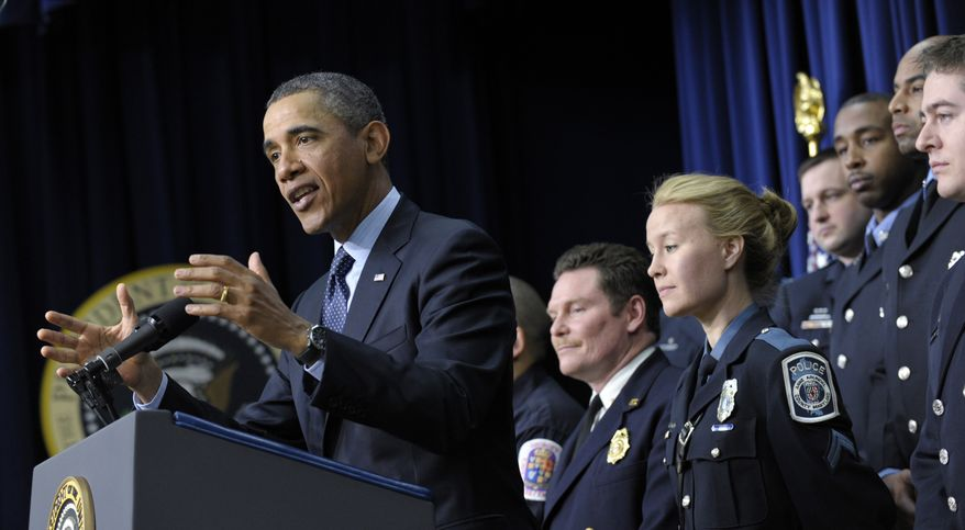 President Obama, accompanied by first responders behind him, speaks in the South Court Auditorium of the Eisenhower Executive Office building on the White House complex in Washington on Feb. 19, 2013, to urge Congress to come up with an alternative plan to avert automatic spending cuts set to kick in on March 1. (Associated Press)