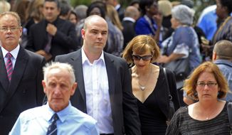 Adam Steenkamp (center left), the brother of Reeva Steenkamp, walks with family members after attending her funeral in Port Elizabeth, South Africa, on Tuesday, Feb. 19, 2013. (AP Photo/Schalk van Zuydam)
