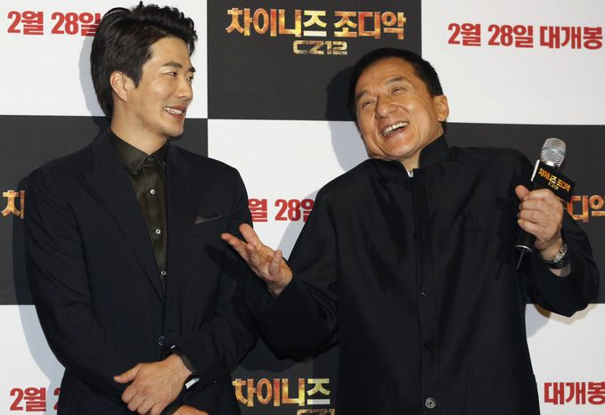 """Hong Kong actor-director Jackie Chan (right) and South Korean actor Kwon Sang-woo promote their latest movie, """"CZ12,"""" or """"Chinese Zodiac,"""" in Seoul on Monday, Feb. 18,"""