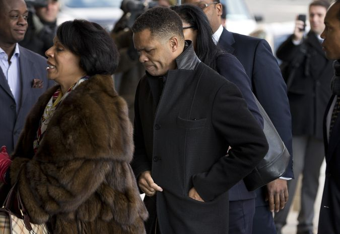 ** FILE ** Former Illinois Rep. Jesse Jackson Jr. and his legal team arrives at the E. Barrett Prettyman Federal Courthouse in Washington on Feb. 20, 2013. (Associated Press