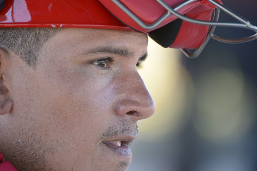 Washington Nationals catcher Carlos Maldonado watches from the dugout during a spring training baseball workout in Viera, Fla., Wednesday, Feb. 20, 2013.(AP Photo/Phelan M. Ebenhack)