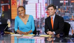 """Co-anchors Robin Roberts (left) and George Stephanopoulos appear on ABC's """"Good Morning America"""" on Wednesday, Feb. 20, 2013, in New York. Miss Roberts returned to the popular morning program after undergoing a bone marrow transplant five months ago. (AP Photo/ABC, Heidi Gutman)"""