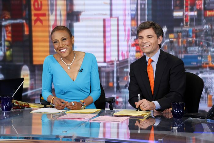 "Co-anchors Robin Roberts (left) and George Stephanopoulos appear on ABC's ""Good Morning America"" on Wednesday, Feb. 20, 2013, in New York. Miss Roberts returned to the popular morning program after undergoing a bone marrow transplan"