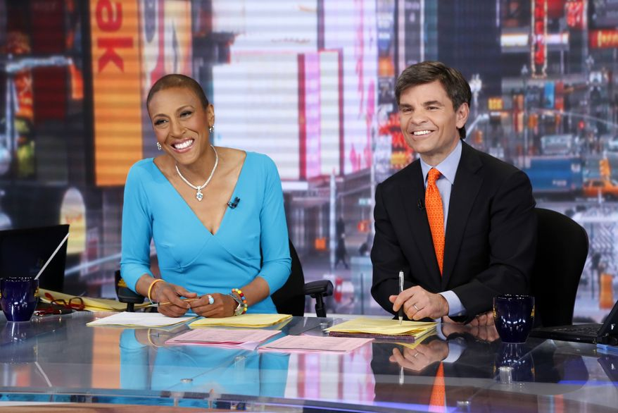 "Co-anchors Robin Roberts (left) and George Stephanopoulos appear on ABC's ""Good Morning America"" on Wednesday, Feb. 20, 2013, in New York. Miss Roberts returned to the popular morning program after undergoing a bone marrow transplant five months ago. (AP Photo/ABC, Heidi Gutman)"