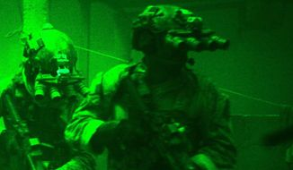 "This undated publicity photo released by Columbia Pictures Industries, Inc. shows Navy SEALs seen through the greenish glow of night vision goggles, as they prepare to breach a locked door in Osama Bin Laden's compound in Columbia Pictures' hyper-realistic new action thriller from director Kathryn Bigelow, ""Zero Dark Thirty."" (AP Photo/Columbia Pictures Industries, Inc., Jonathan Olley)"