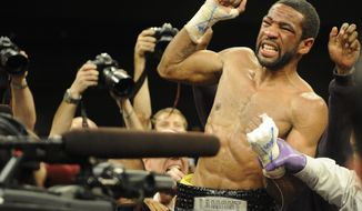 **FILE** Lamont Peterson celebrates his win over Amir Khan, of England, not seen, in a boxing match, Sunday, Dec. 11, 2011, in Washington. (AP Photo/Nick Wass)