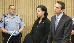 Amanda Bowden stands with her public defender as she is arraigned at Superior Court in Milford, Conn., Wednesday, Feb. 20, 2013. She is accused of threatening to commit a suicide bombing and mass shooting at Gateway Community College in New Haven. (AP Photo/New Haven Register, Rich Scinto)