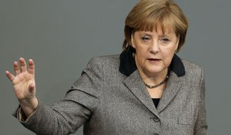 ** FILE ** German Chancellor Angela Merkel gestures during a government statement as part of a meeting of the German federal parliament, Bundestag, in Berlin, Germany, Thursday, Feb. 21, 2013. (AP Photo/Michael Sohn)