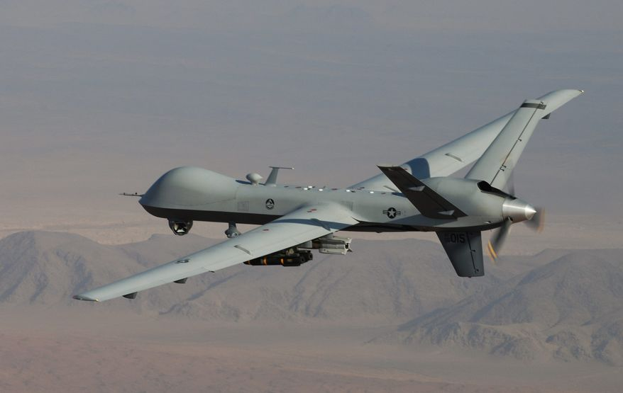 ** FILE ** In this undated handout file photo provided by the U.S. Air Force, an MQ-9 Reaper, armed with GBU-12 Paveway II laser guided munitions and AGM-114 Hellfire missiles, is piloted by Col. Lex Turner during a combat mission over southern Afghanistan. An instruction on camouflaging cars is one of 22 tips on how to avoid drones, listed on a document left behind by the Islamic extremists as they fled northern Mali from a French military intervention in January. (AP Photo/Lt. Col.. Leslie Pratt, US Air Force, File)