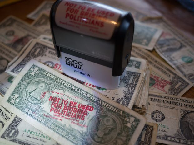 Ben & Jerry's wants customers to eat their ice cream, and stamp campaign finance reform slogans on money. (Ben & Jerry's)