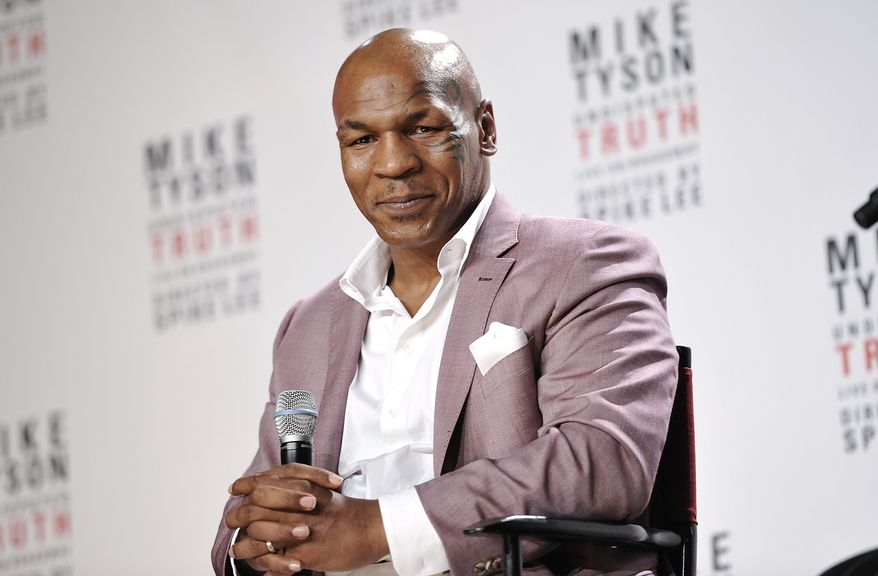 """Former heavyweight boxing champion Mike Tyson announces """"Mike Tyson: Undisputed Truth,"""" a one-man Broadway show, in New York on Tuesday, June 18, 2012. (Evan Agostini/Invision/AP)"""