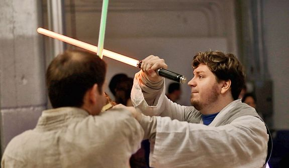 Golden Gate Knights instructor Frank Knight (right) works with Jim Collum during class in San Francisco on Feb. 10, 2013. A group of San Francisco Star Wars fans who want to travel to a galaxy not that far away have created a combat choreography class for Jedis-in-training with their weapon of choice: the light saber. (Associated Press)