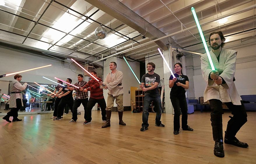 Golden Gate Knights instructor Alain Block, right, teaches during class in San Francisco on Feb. 10, 2013. A group of San Francisco Star Wars fans who want to travel to a galaxy not that far away have created a combat choreography class for Jedis-in-training with their weapon of choice: the light saber. (Associated Press)