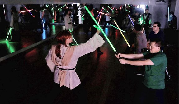 Golden Gate Knights students practice light saber techniques during class in San Francisco on Feb. 10, 2013. A group of San Francisco Star Wars fans who want to travel to a galaxy not that far away have created a combat choreography class for Jedis-in-training with their weapon of choice: the light saber. (Associated Press)