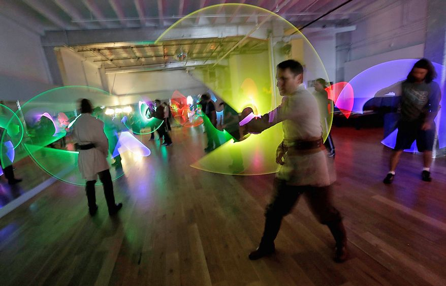 Jim Collum (foreground) and other students work on light saber skills during a Golden Gate Knights class in San Francisco on Feb. 10, 2013. A group of San Francisco Star Wars fans who want to travel to a galaxy not that far away have created a combat choreography class for Jedis-in-training with their weapon of choice: the light saber. (Associated Press)