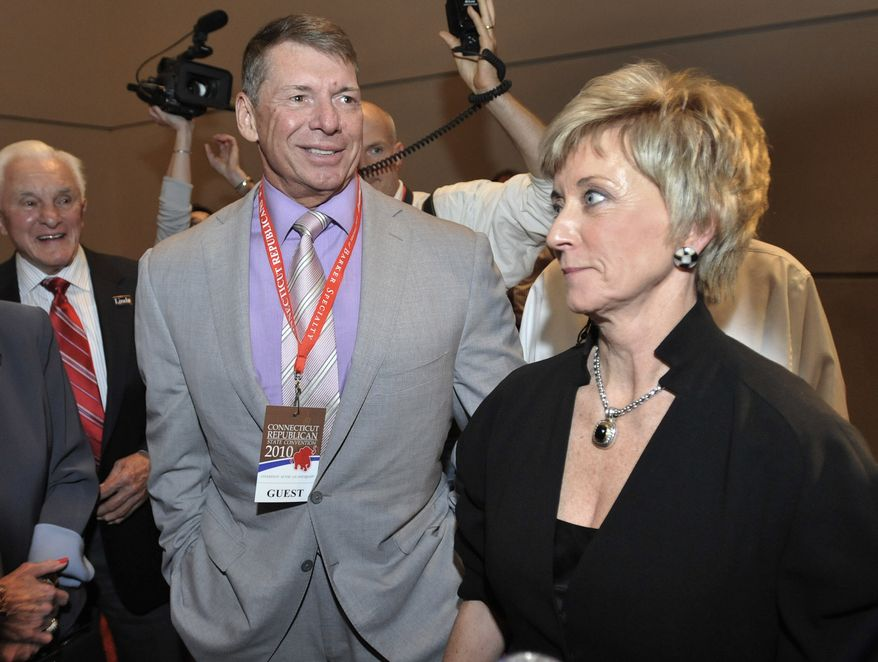 **FILE** Republican candidate for U.S. Senate Linda McMahon (right) and husband Vince McMahon wait for delegate totals to be tallied during the Republican nomination at the Connecticut Republican Convention in Hartford, Conn., on May 21, 2010. (Associated Press)