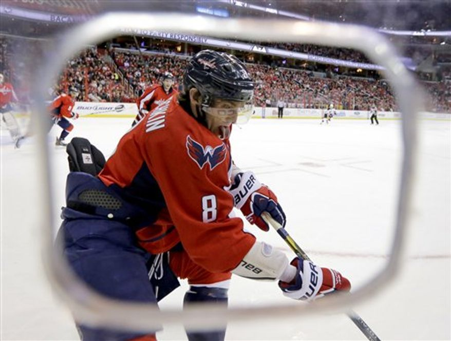 Washington Capitals left wing Alex Ovechkin (8), of Russia, goes for the puck in the first period of an NHL hockey game against the New Jersey Devils, Thursday, Feb. 21, 2013, in Washington. The Devils won 3-2. (AP Photo/Alex Brandon)