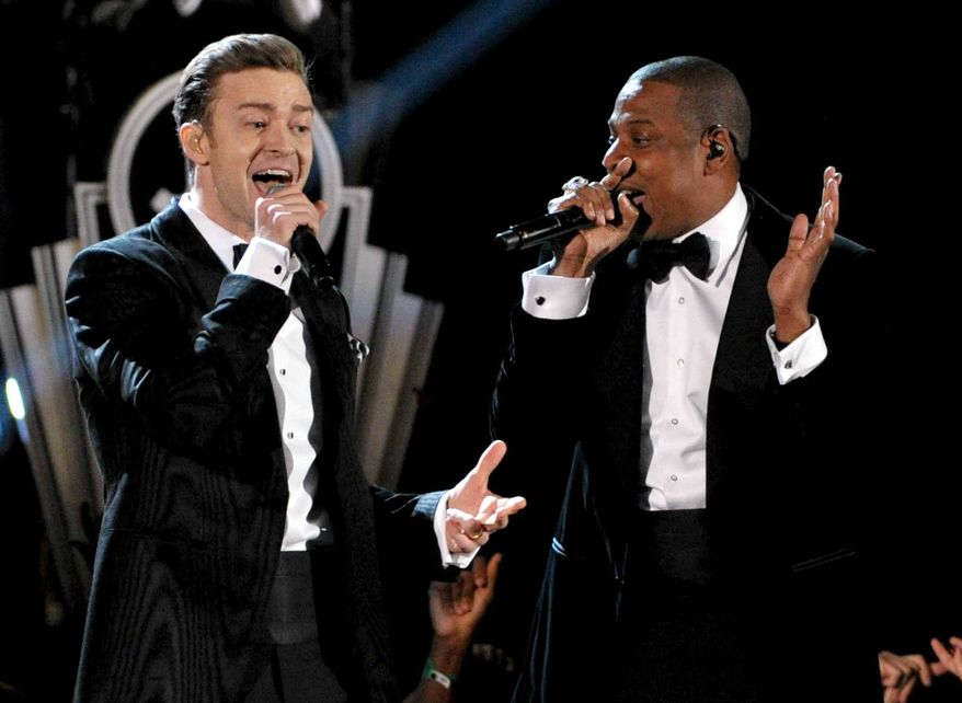 ** FILE ** This Feb. 10, 2013, file photo shows recording artists Just Timberlake, left, and Jay-Z performing at the 55th annual Grammy Awards in Los Angeles. On Friday, Feb. 22, the pair announced their 12-city Legends of the Summer tour beginning July 17 in Toronto and ending Aug. 16 in Miami. (Photo by John Shearer/Invision/AP, file)