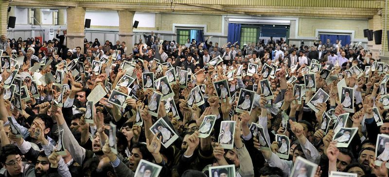 In this photo released by the official website of the Iranian supreme leader's office, Iranian well-wishers attending the speech of Supreme Leader Ayatollah Ali Khamenei hold up his picture at a mosque inside the leader's housing compound in Tehran, Iran, Saturday, Feb. 16, 2013. Khamenei said Saturday that his country is not seeking nuclear weapons, but that no world power could stop Tehran's access to an atomic bomb if it intended to build one. (AP Photo/Office of the Supreme Leader)
