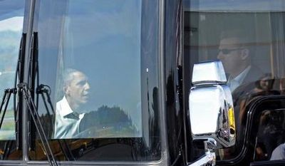 President Obama boards his bus after speaking at Asheville Regional Airport in Fletcher, N.C., on Oct. 17, 2011, to begin his three-day bus tour promoting the American Jobs Act. (Associated Press)