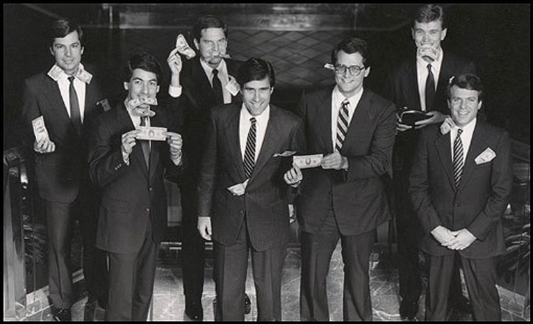 Former Republican presidential nominee Mitt Romney poses with money during a playful photoshoot with Bain Capital partners in the 1980s. (Credit: Boston Globe)