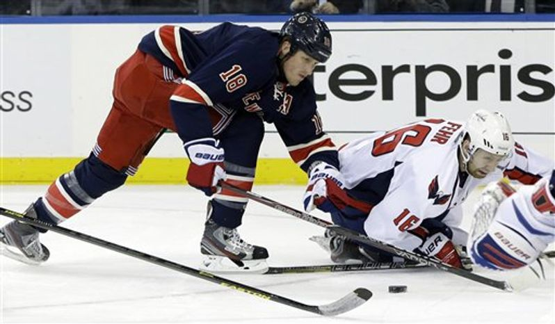 Under a new NHL realignment proposal reported by CBC, the Capitals and Rangers would play in the same division beginning in 2013-14. (Associated Press)
