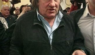 French actor Gerard Depardieu arrives for the opening ceremony of the Illusion movie theater after its restoration in Moscow, Russia, Friday, Feb. 22. (Associated Press)