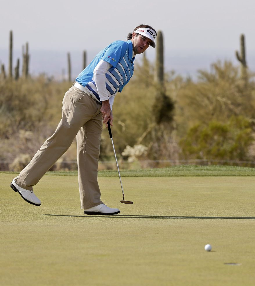 Bubba Watson reacts as his putt misses on the fourth green in the second round of play against Jim Furyk during the Match Play Championship golf tournament, Friday, Feb. 22, 2013, in Marana, Ariz. (AP Photo/Julie Jacobson)