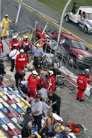 Spectators are injured after a tire and engine off Kyle Larson's car flew into the stands during a crash at the conclusion of the NASCAR Nationwide Series auto race Saturday, Feb. 23, 2013, at Daytona International Speedway in Daytona Beach, Fla. (AP Photo/David