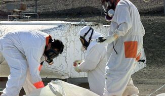 ** FILE ** Workers at the tank farms on the Hanford Nuclear Reservation near Richland, Wash., measure for radiation and the presence of toxic vapors in March, 2004. (Associated Press)