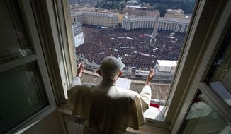 Pope Benedict XVI delivers his blessing during his last Angelus noon prayer from the window of his studio overlooking St. Peter's Square at the Vatican on Sunday, Feb. 24, 2013. (AP Photo/L'Osservatore Romano)