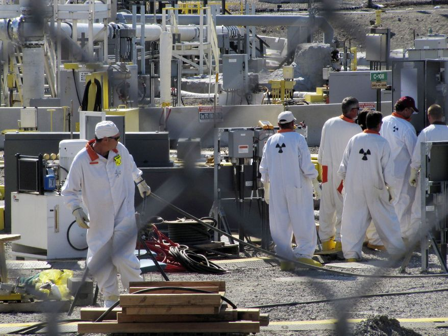 Workers at the Hanford Nuclear Reservation near Richland, Wash., are on duty at an underground tank farm where highly radioactive waste is stored on July 14, 2010. (AP Photo/Shannon Dininny)