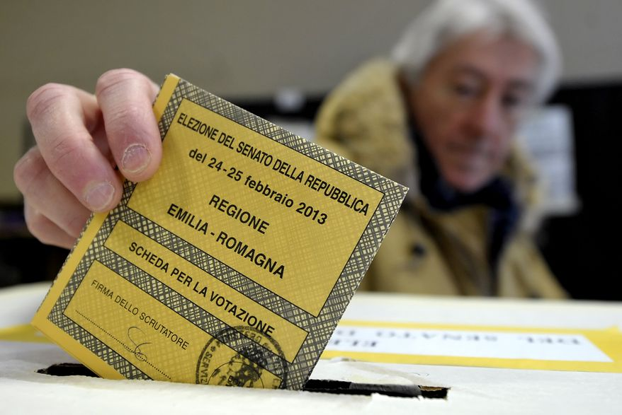 An Italian in Piacenza, Italy, casts his vote for the Senate on Sunday, Feb. 24, 2013. The country is voting in watershed parliamentary elections Sunday and Monday that could shape the future of one of Europe's biggest economies. (AP Photo/Marco Vasini)