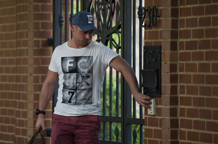 Carl Pistorius, brother of Olympic athlete Oscar Pistorius, arrives on Sunday, Feb. 24, 2013, at the home where his brother has been staying in Pretoria, South Africa, since being granted bail Friday for the Valentine's Day shooting death of his girlfriend, Reeva Steenkamp. Reports emerged Sunday that Carl Pistorius is facing charges of culpable homicide for the death of a female biker who was knocked down in 2010. (AP Photo)