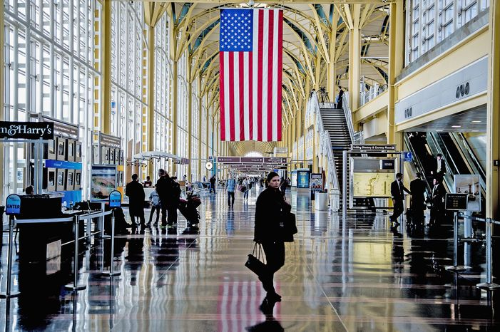 Travelers walk along the main concourse at Ronald Reagan Washington National Airport on Monday, Feb. 25, 2013. (Andrew S. Ge