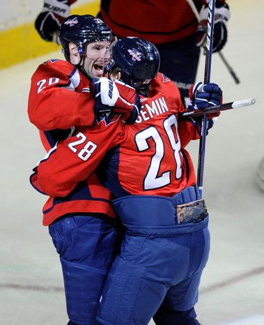 **FILE** Washington Capitals left wing Troy Brouwer (20) celebrates his goal with teammate Alexander Semin (28), of Russia, during the first period of an NHL hockey game against the Tampa Bay Lightning, Friday, Jan. 13, 2012, in Washington. (AP Photo/Nick Wass)